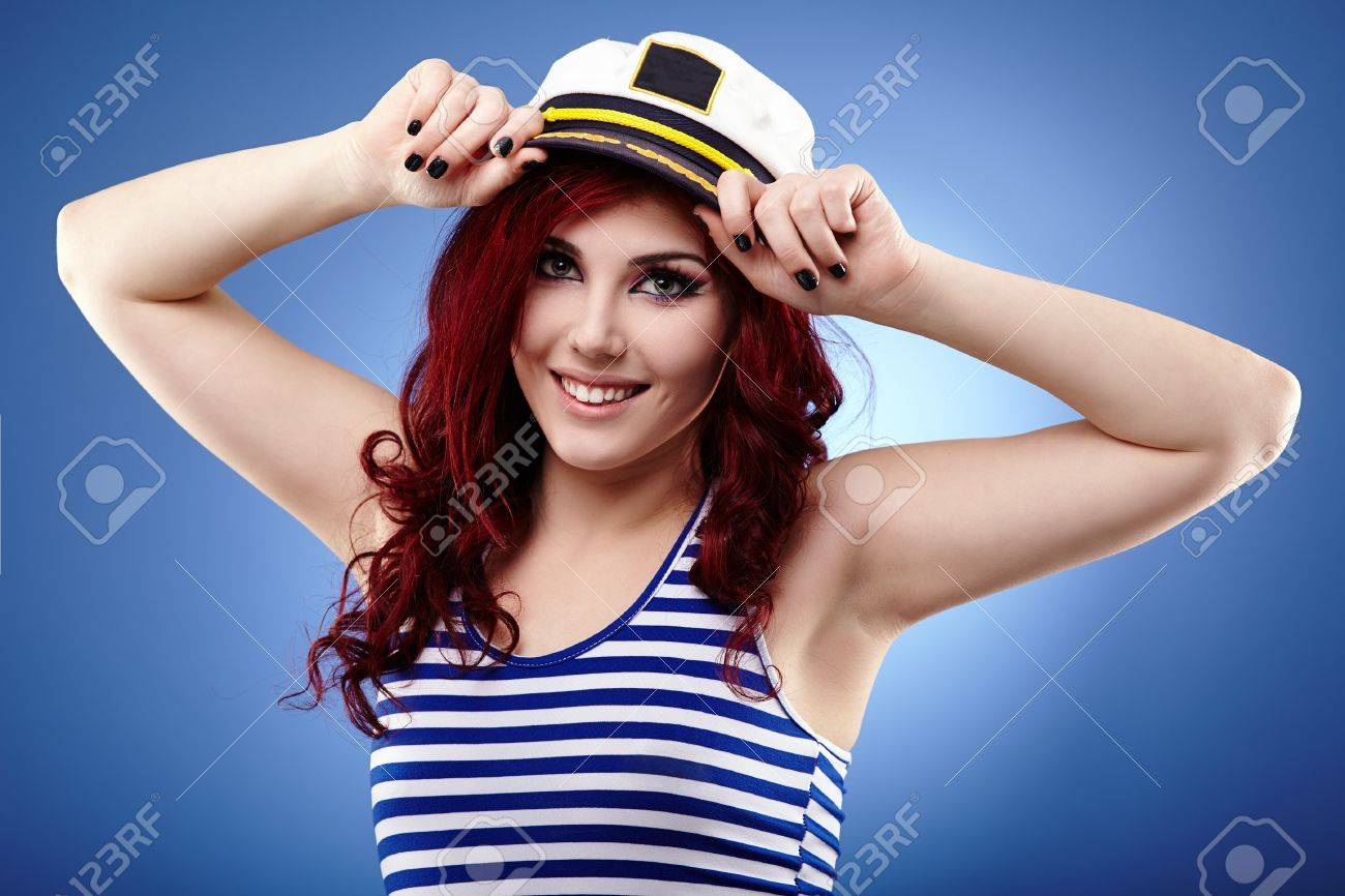 Young woman sailor in glamour closeup pose, over blue background Stock Photo - 18845495
