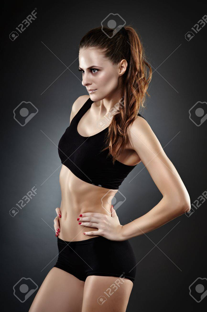Beautiful athletic young woman in sportswear on gray background Stock Photo - 21875563