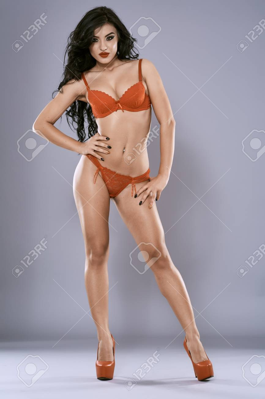 Beautiful hispanic lingerie model in full length studio shoot