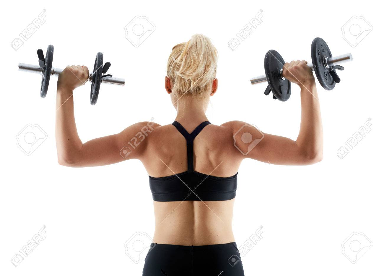 Young Woman Doing Shoulder Workout With Dumbbells Isolated On