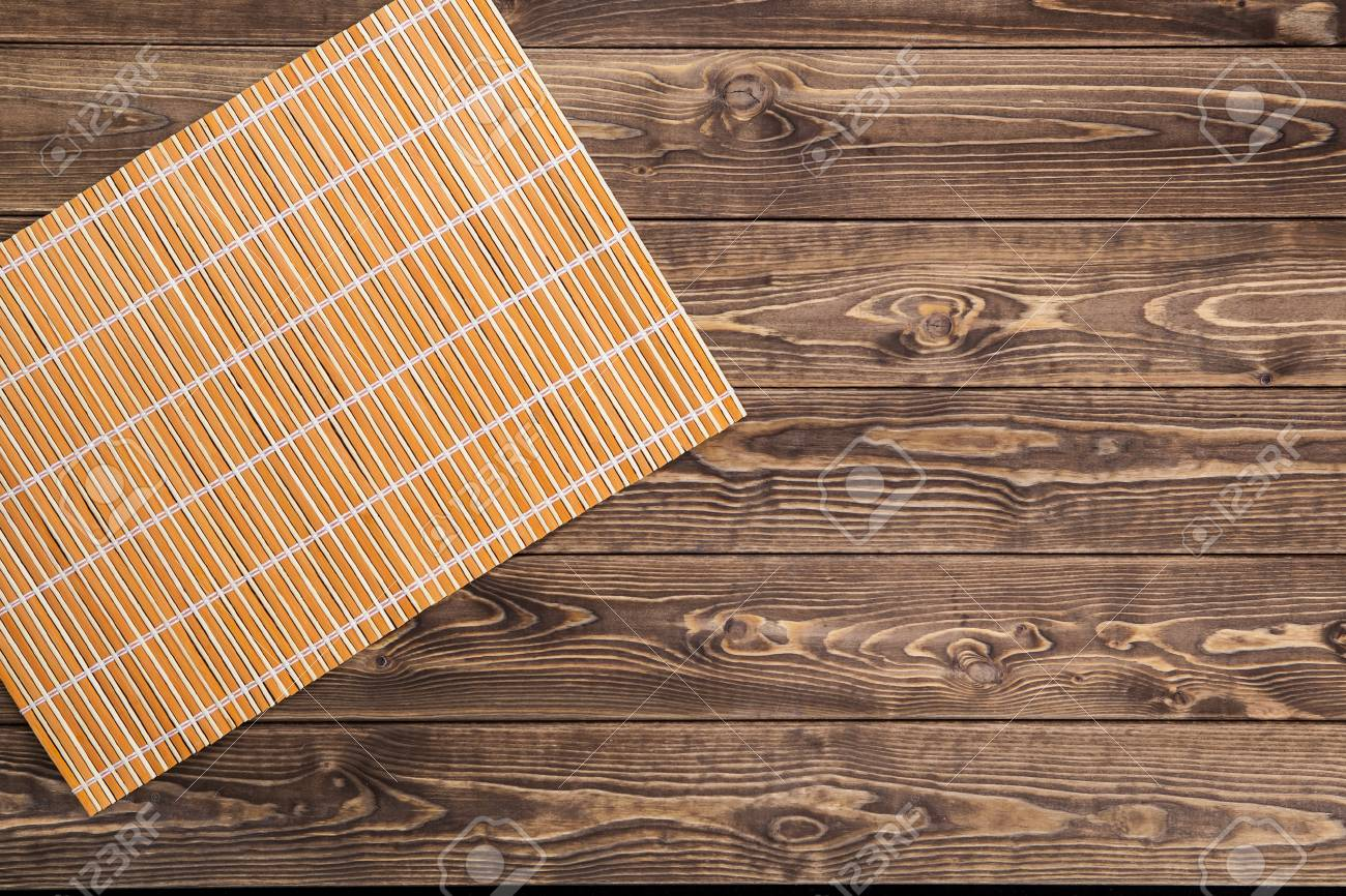 Bamboo Tablecloth On Wooden Table Over Grunge Background. Ready For Product  Display Montage Stock Photo