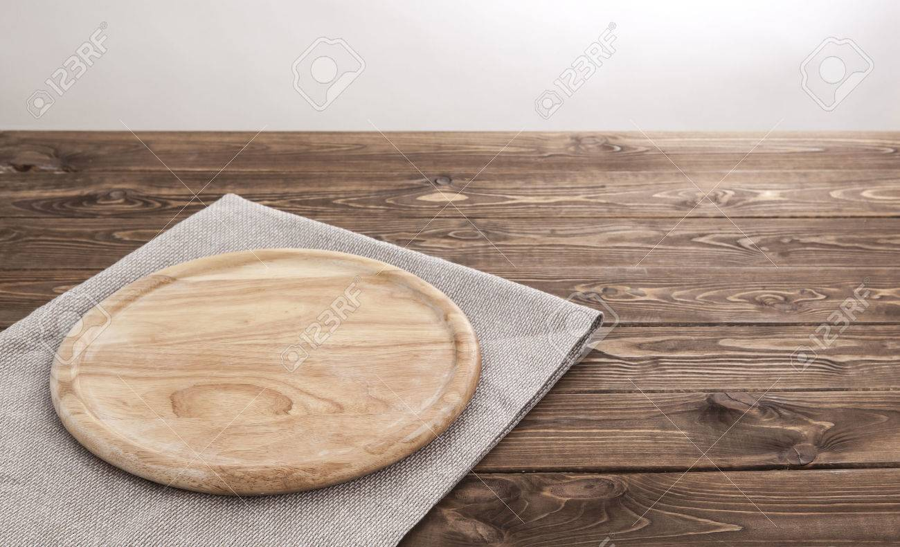 Background for product montage. Empty round wooden board with tablecloth. - 55466104