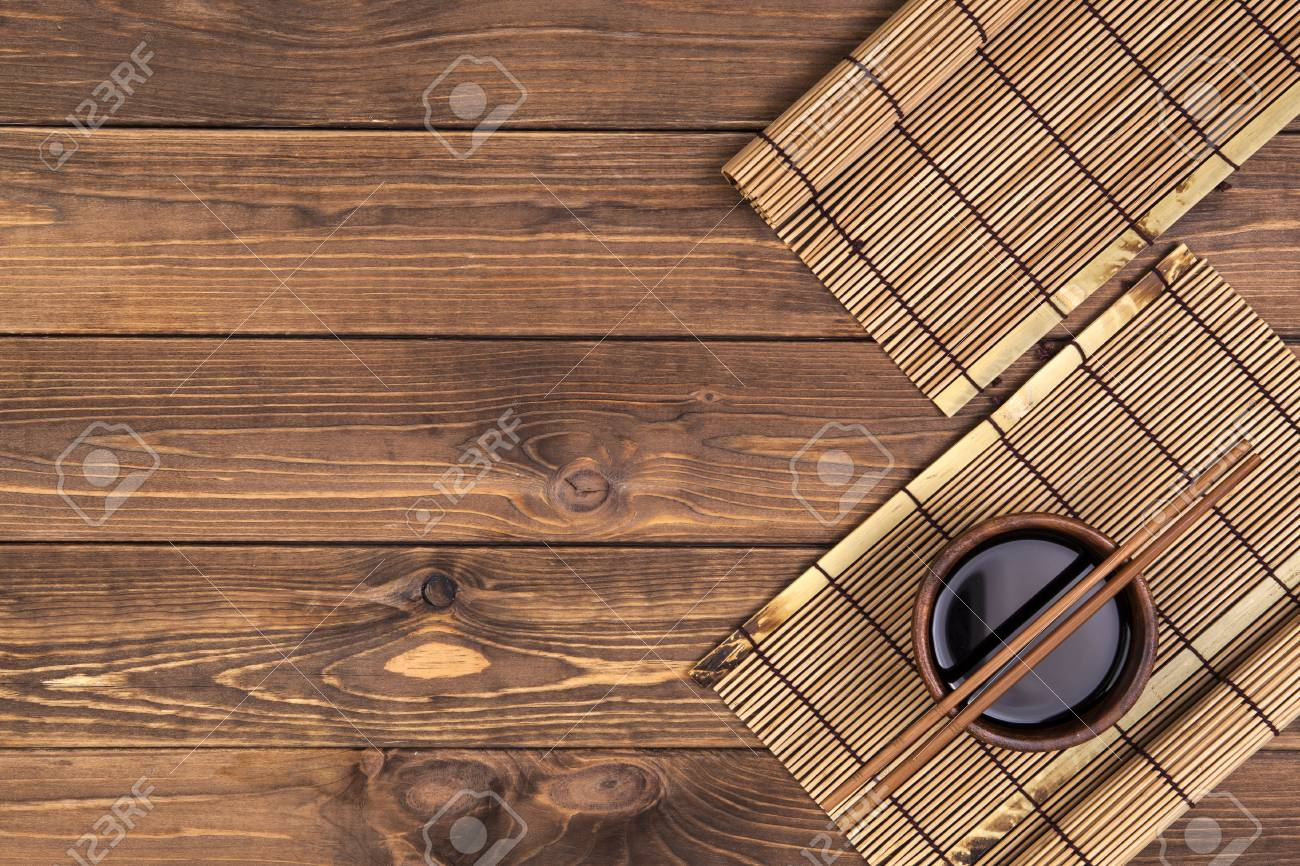 Background For Sushi Bamboo Mat Soy Sauce Chopsticks On Wooden