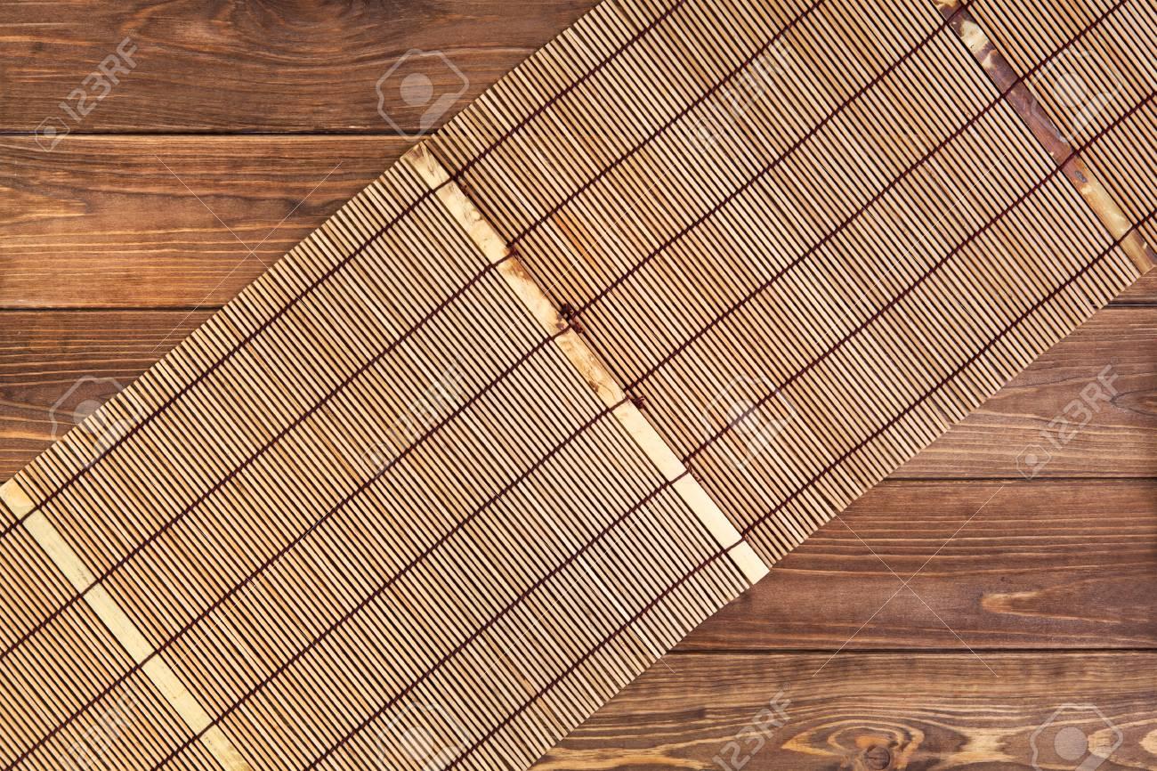 Bambusmatte Fur Sushi Auf Holzernem Hintergrund Draufsicht Mit