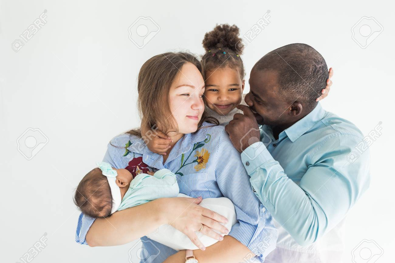 Family portrait on a white background happy multiethnic family family values stock photo