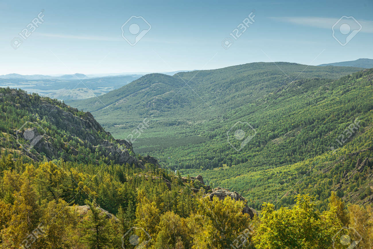 evergreen fir forest on a hilltop among the mountains of the National Park of the Republic of Bashkortostan on Lake Bannoye - 171661280