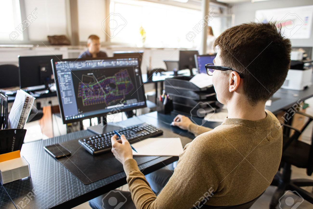 Engineer designer working on desktop computer in factory - 171660289