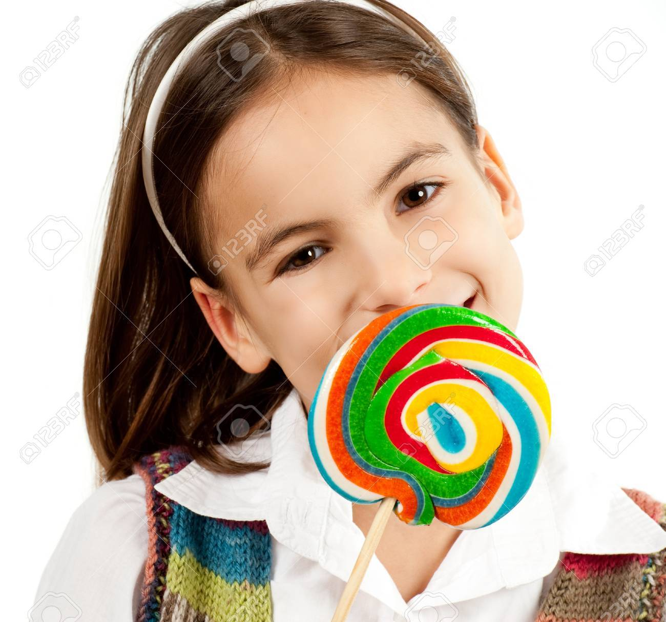little girl with lollipop isolated on white Stock Photo - 12173703