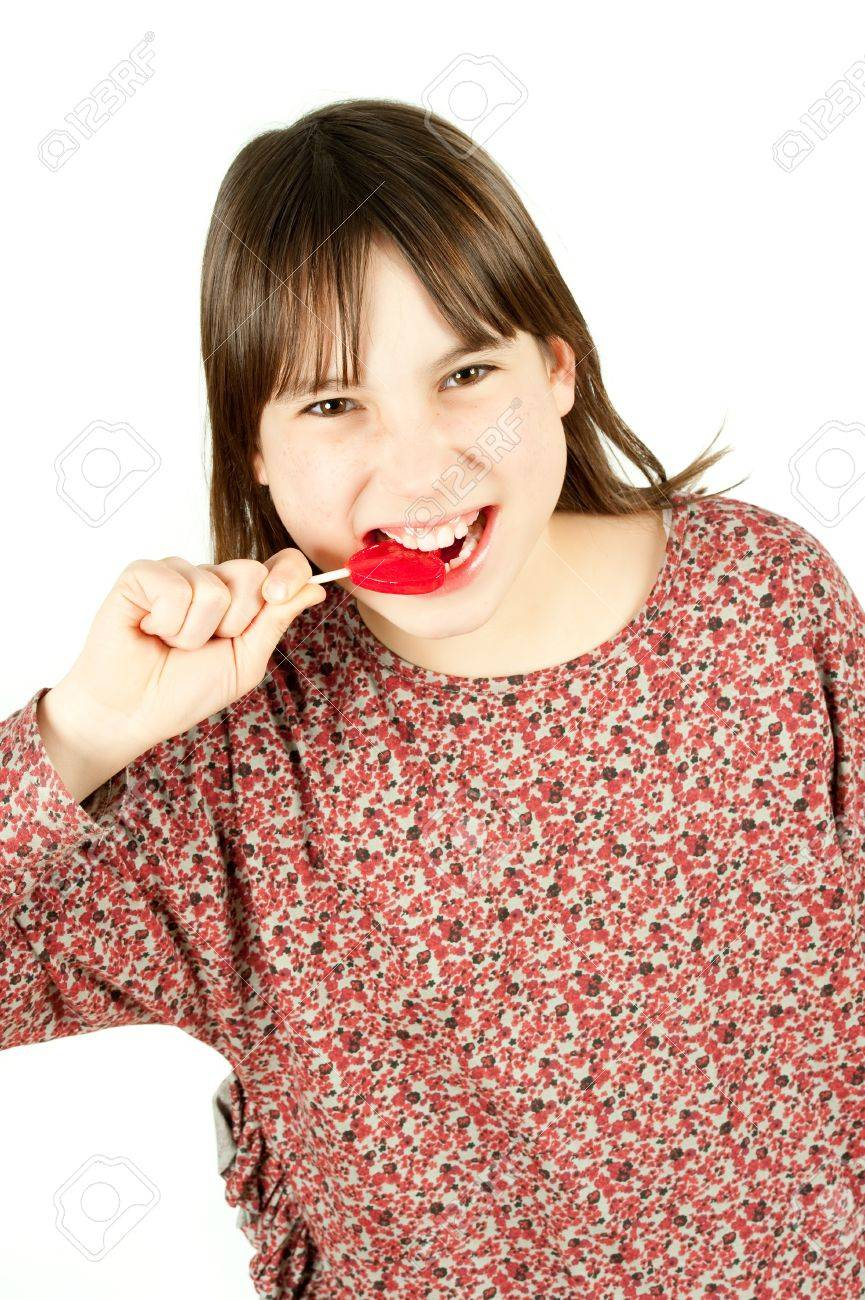 young girl with lollipop isolated on white background Stock Photo - 12470173