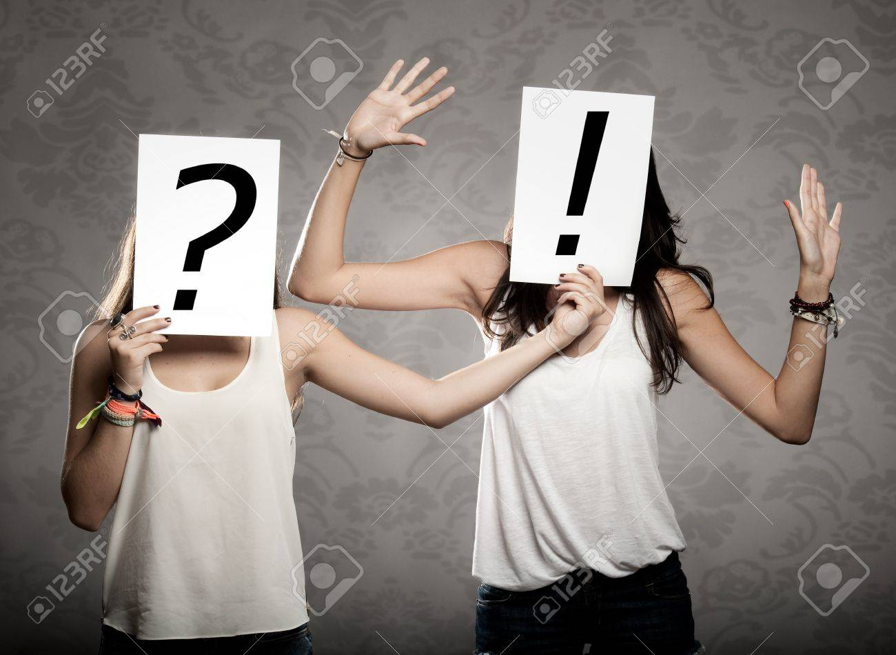 young women with interrogation symbols in front of their faces Stock Photo - 17601311