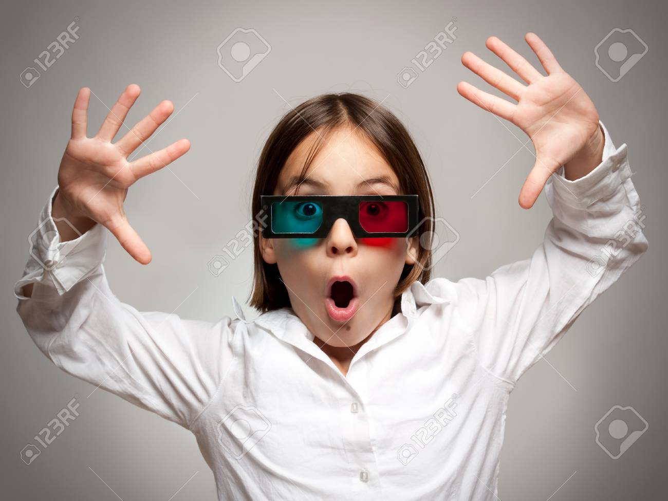 little girl watching a a movie wearing 3d glasses Stock Photo - 17606081