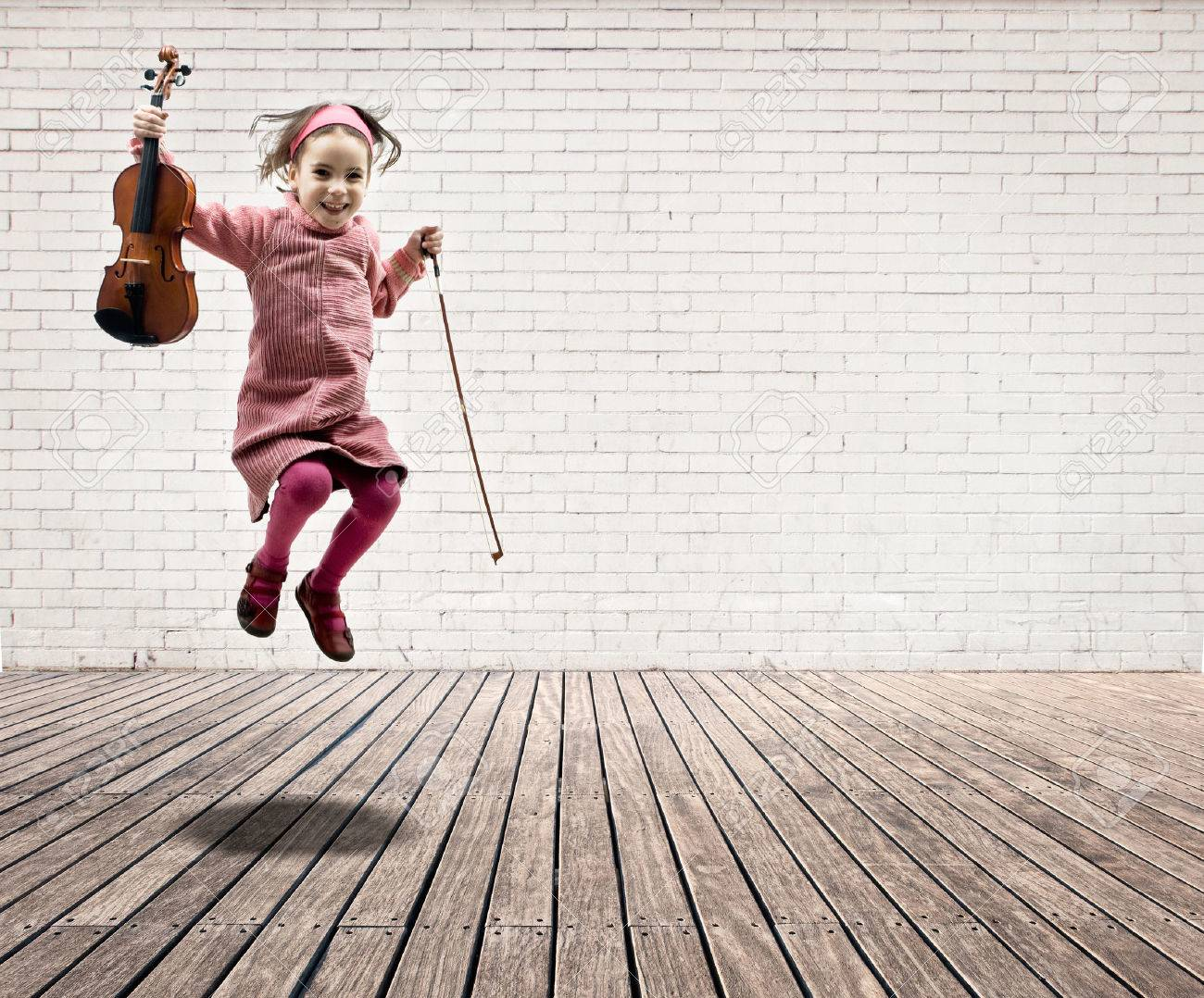 Empty room with chair violin and sheet music on floor photograph - Music Room Little Girl With Violin Jumping On A Room With White Bricks Wall And
