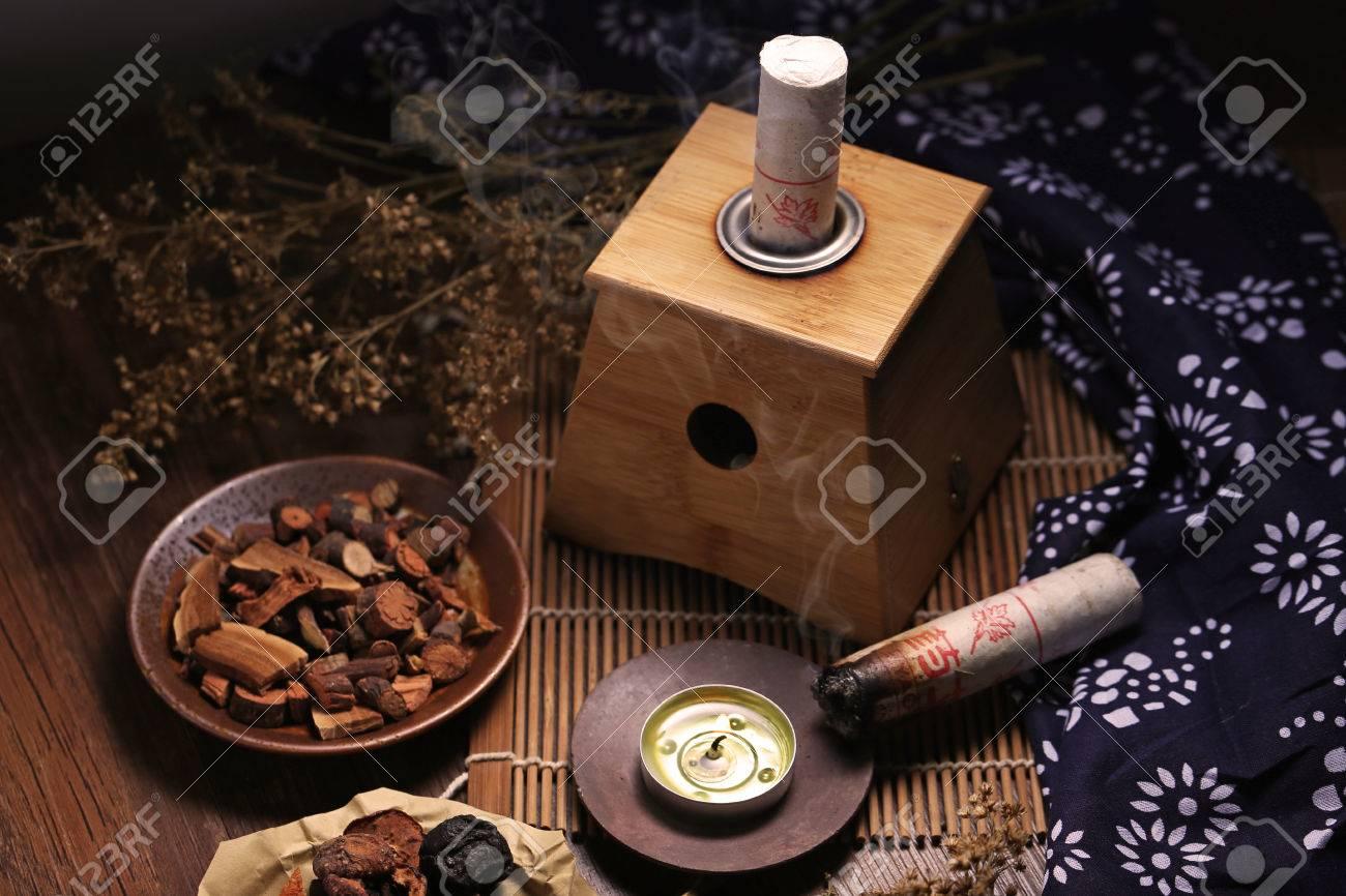 Moxibustion Chinese medicine - 61469730