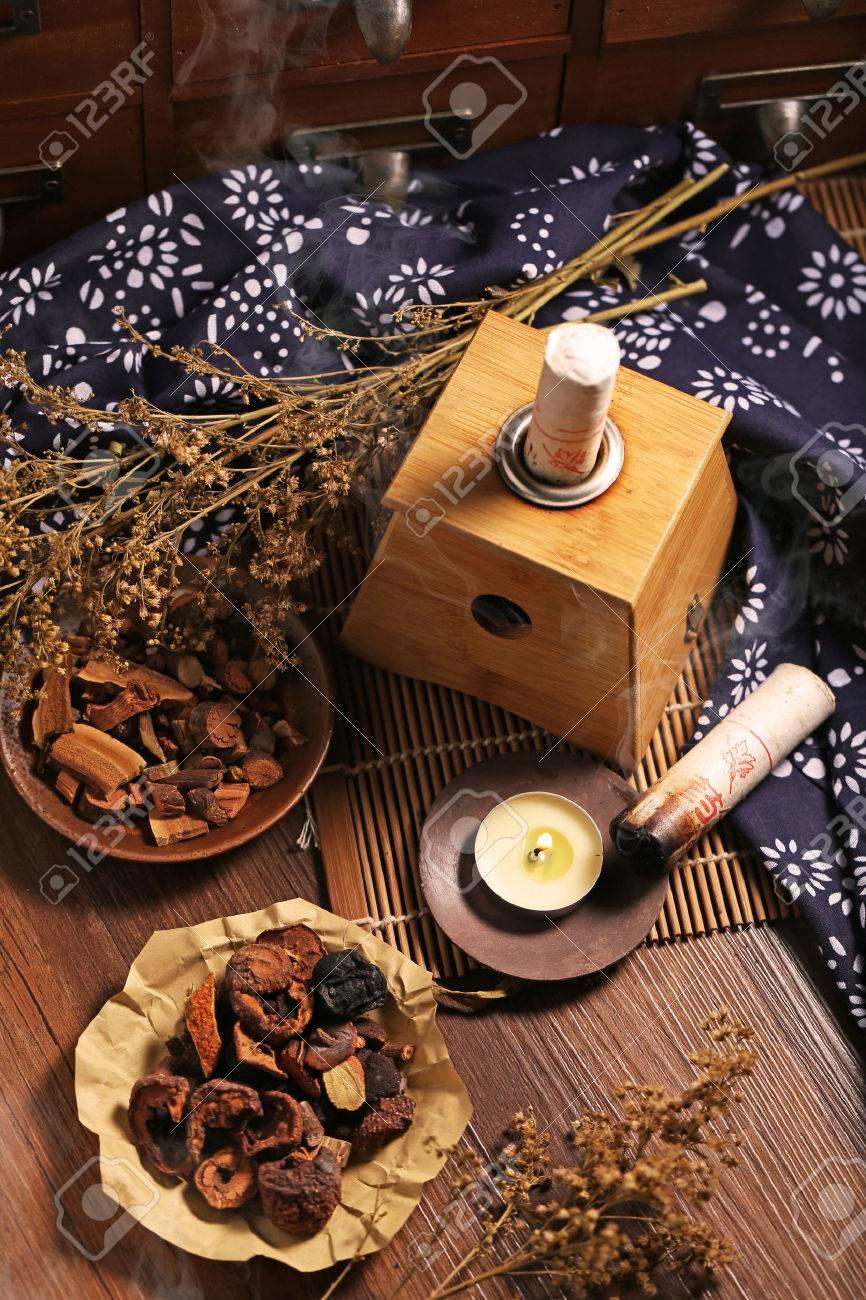 Moxibustion Chinese medicine - 61469732