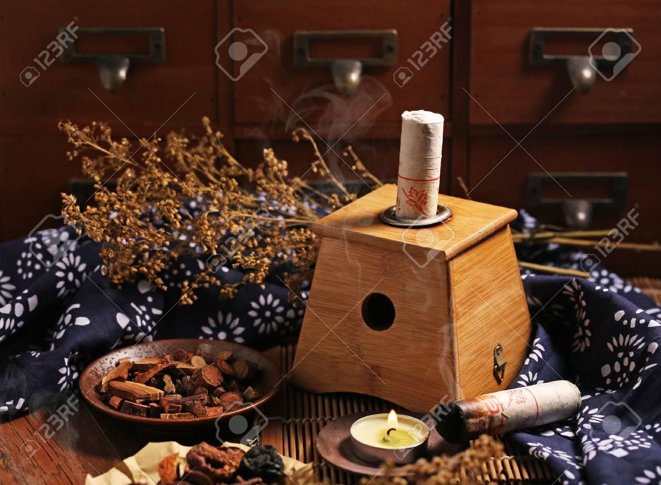 Moxibustion Chinese medicine - 61469772