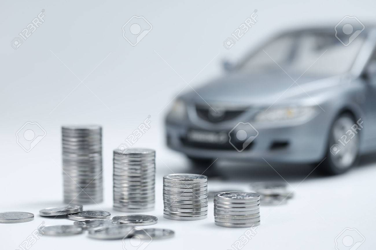 coin stacks in front of car - 67335416