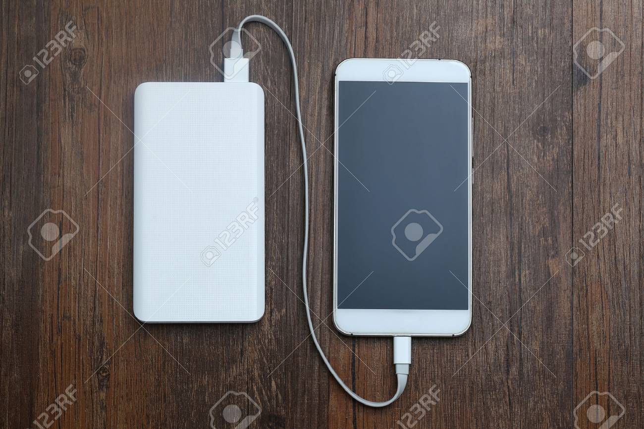 powerbank and cellphone on wooden table - 80548044