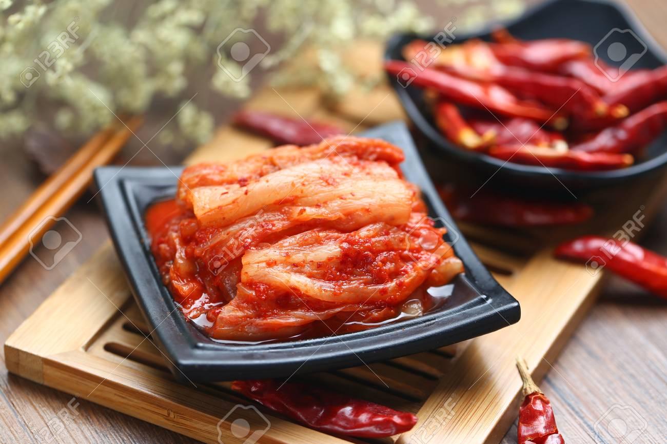 Korean kimchi in black plate on bamboo - 80560622