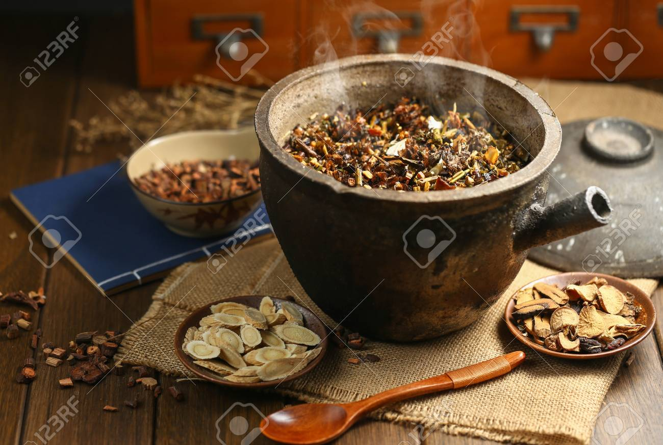 Chinese traditional herbal medicine in casserole - 90655845