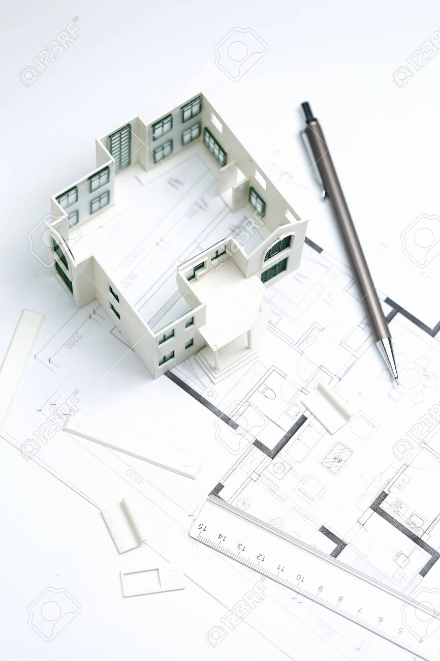 house model,blueprint,pencil and ruler on white background - 116530579