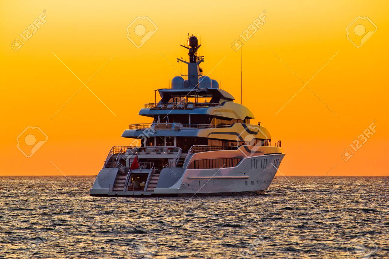 Luxury yacht on open sea at golden sunset - 15488764