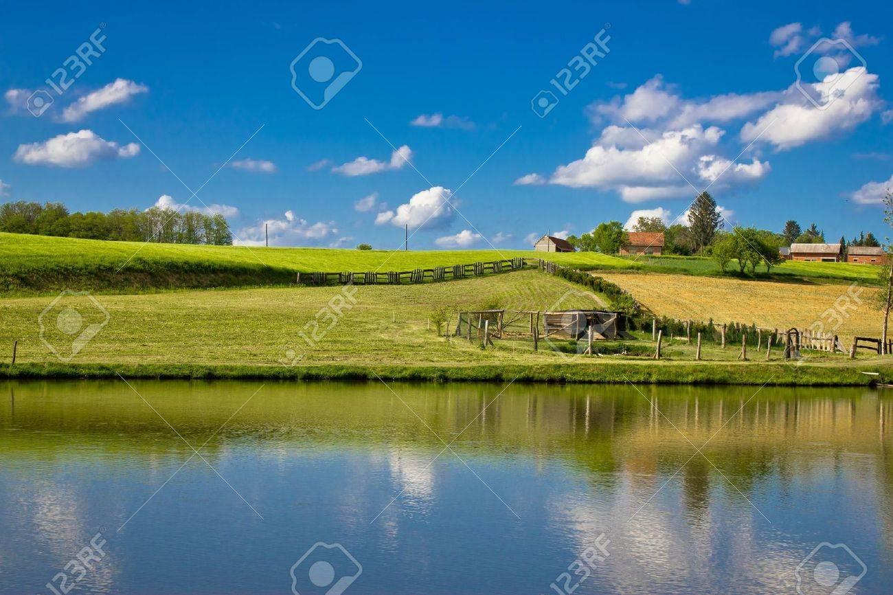 Green landscape and blue lake and sky, Prigorje region, Croatia - 19663752