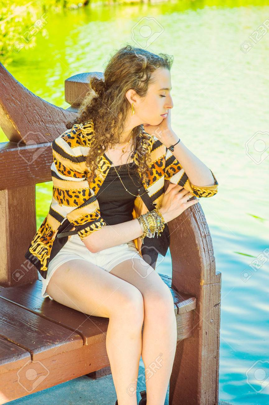 e67a98e2cfd American teenage girl with curly long hair wearing patterned fashionable  jacket, shorts