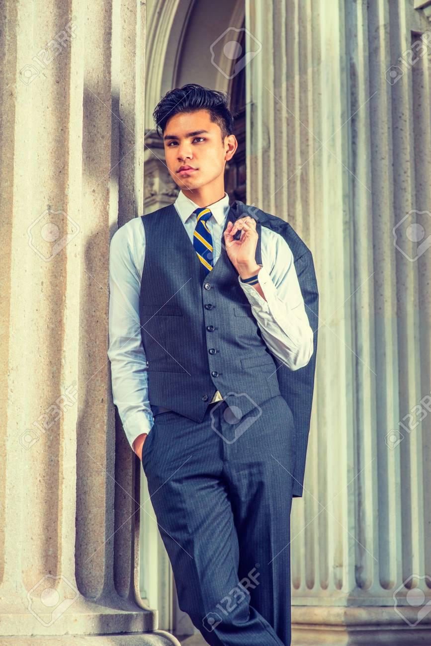 b1ea349b7d Business Man. Dressing in a black suit, white shirt, patterned necktie, vest
