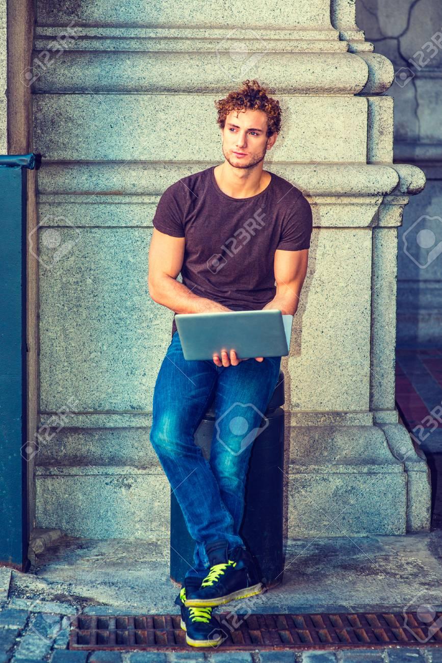 brown shirt blue jeans