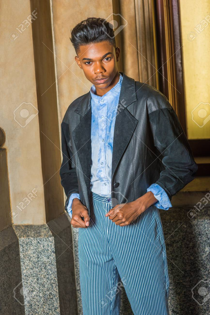 35c7236142 A young,18 years old student, wearing black fashionable jacket, blue dyed  white
