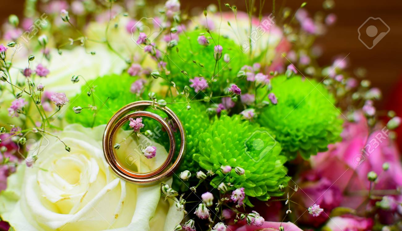 Detail Of Wedding Rind On Beautiful Flowers Wedding Day Background