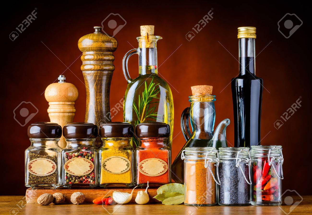 Different Glasses and bottles of Food Seasoning and Spices in still life - 54079540