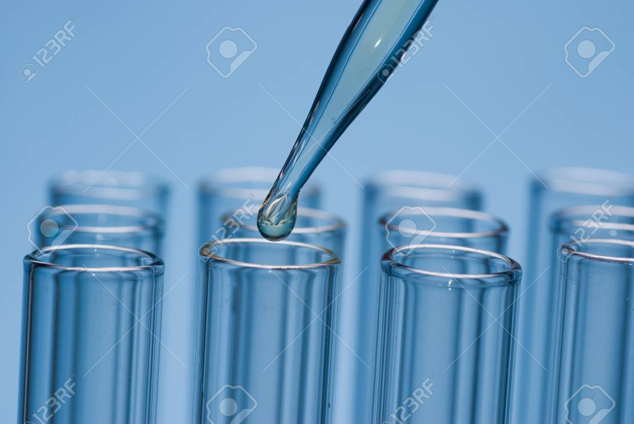 the Pipette put the solution to cuvette Stock Photo - 17833657