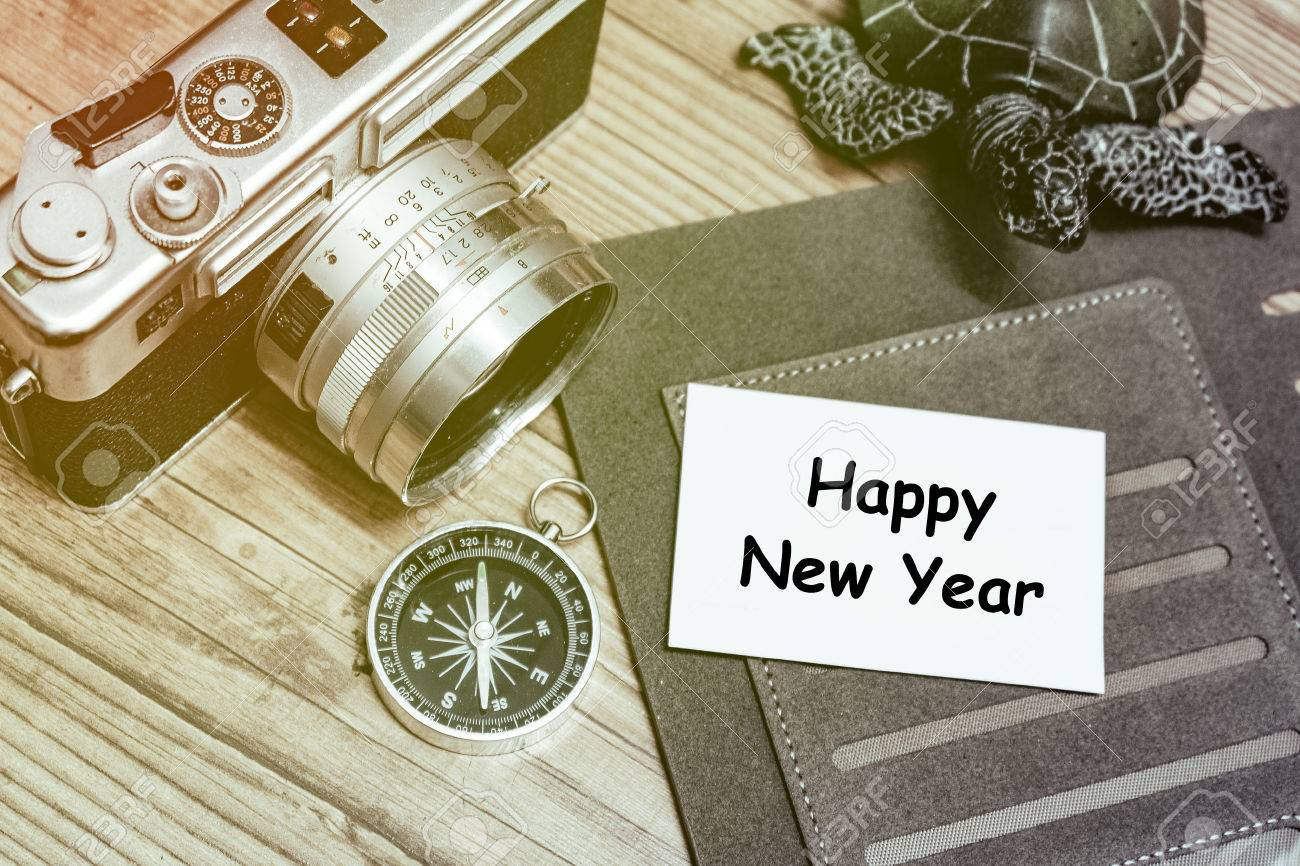 business travel concept image word happy new year on name card personal planner book