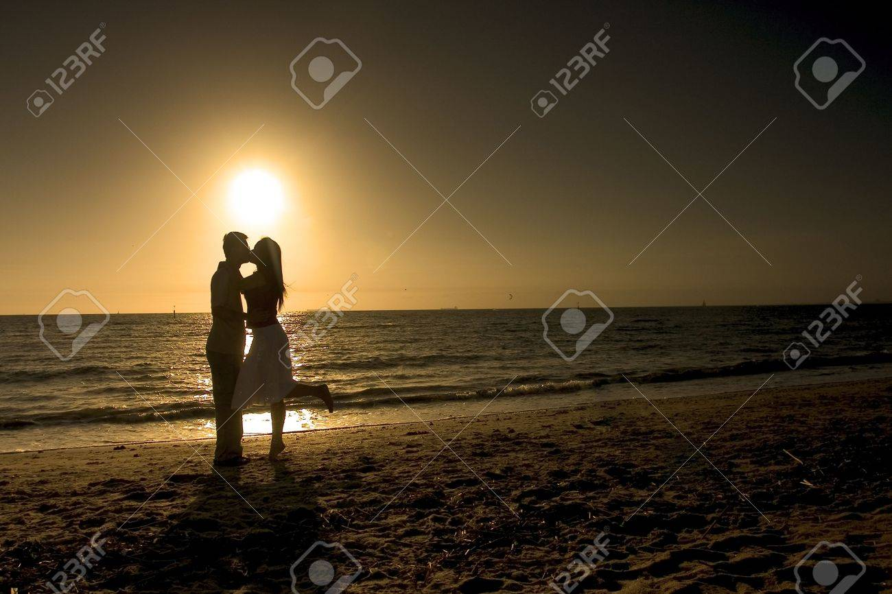 Silhouette of couple kissing at sunset Stock Photo - 238812