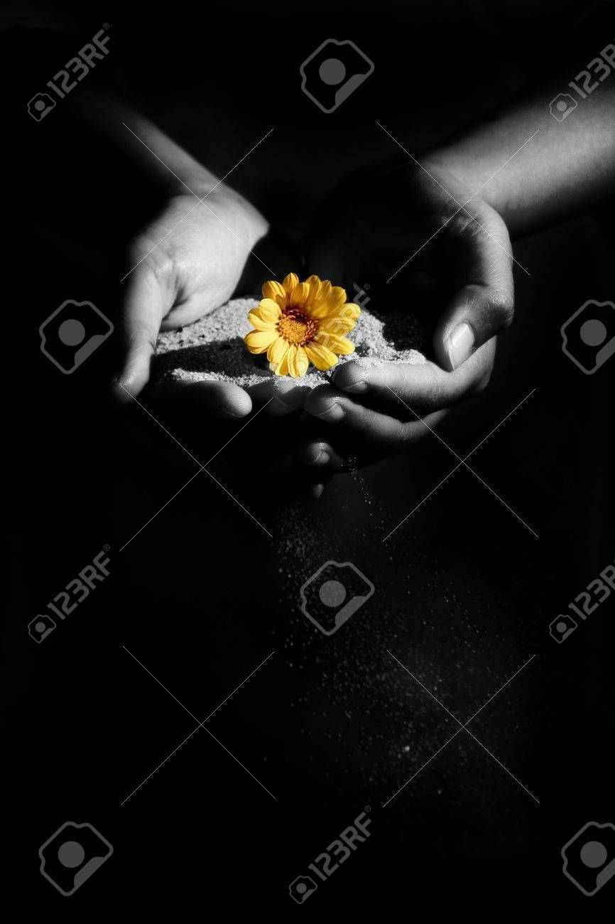a woman holding sand and a flower. Shot was manipulated in PS Stock Photo - 240477