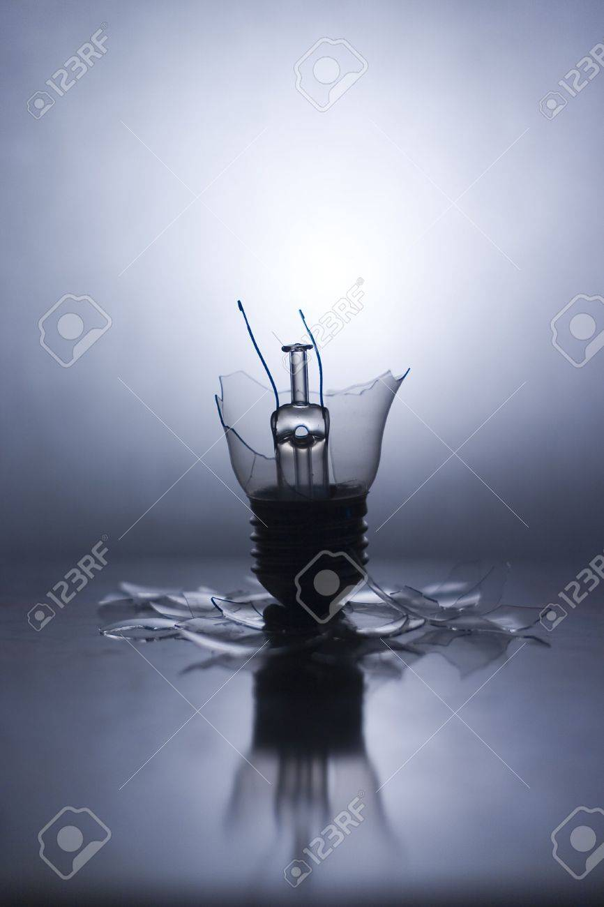 Broken Lightbulb with backlight and reflection Stock Photo - 240472