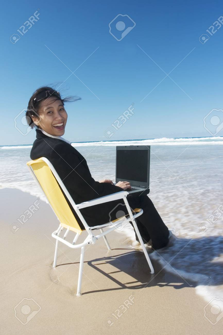 Businesswoman enjoying the day at the beach Stock Photo - 648507