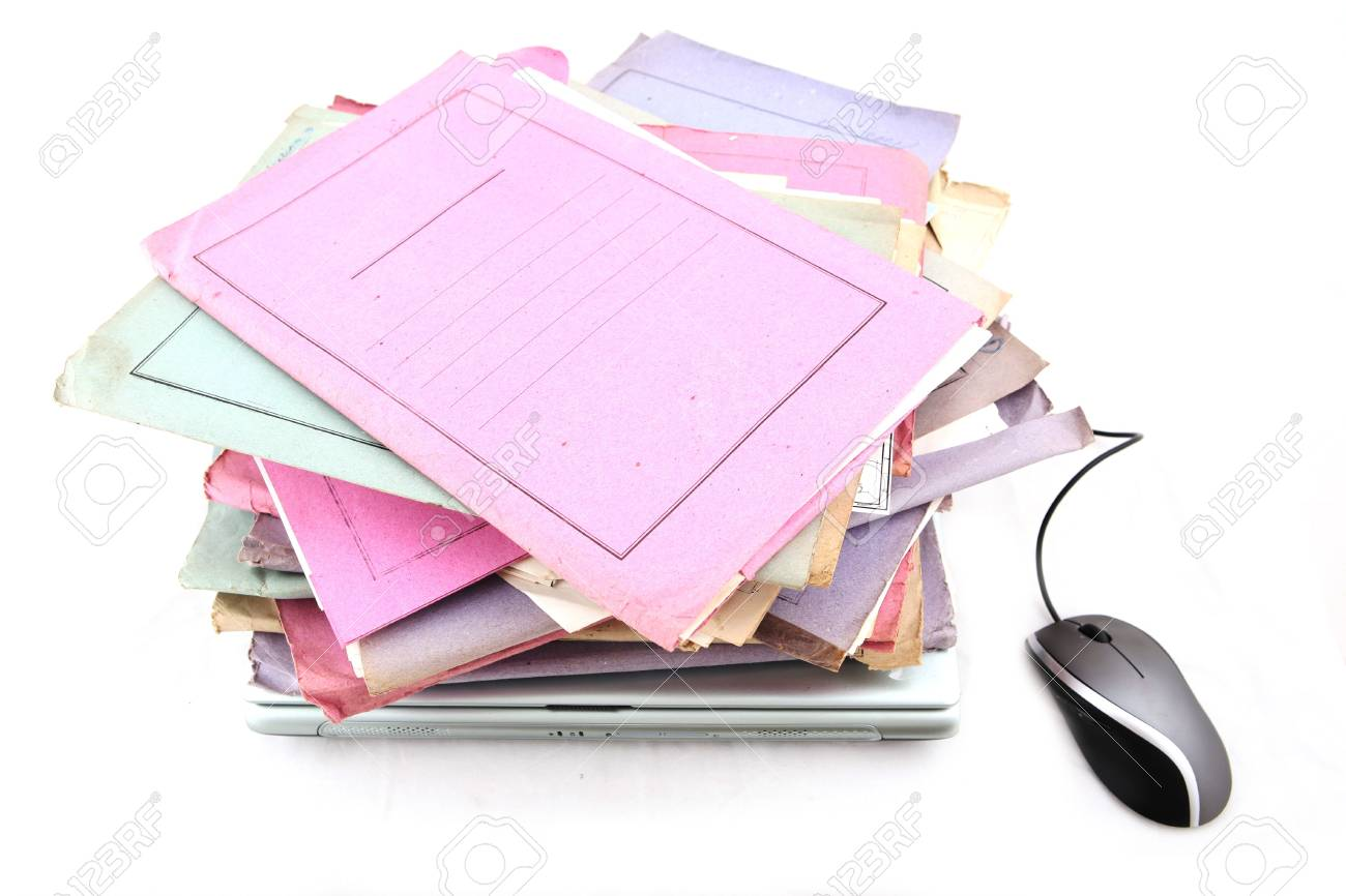 Isolated stack of folders with laptop computer and a mouse shot over white background Stock Photo - 3407925
