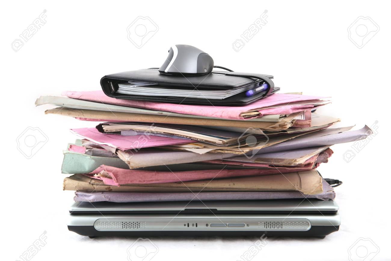 Isolated stack of folders with laptop computer and a mouse shot over white background Stock Photo - 3407922