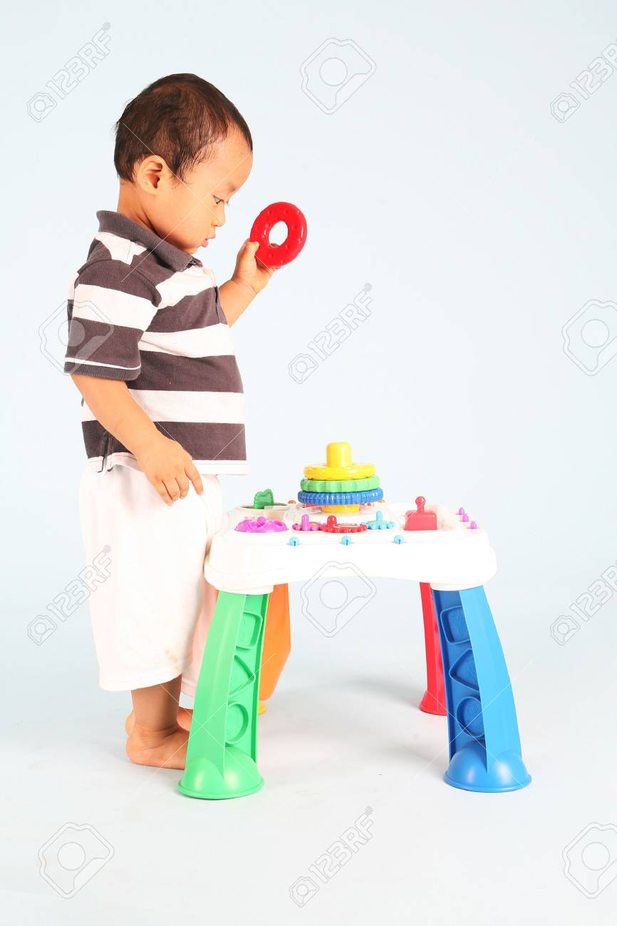 An Unhappy asian toddler playing with his toy alone Stock Photo - 3438787
