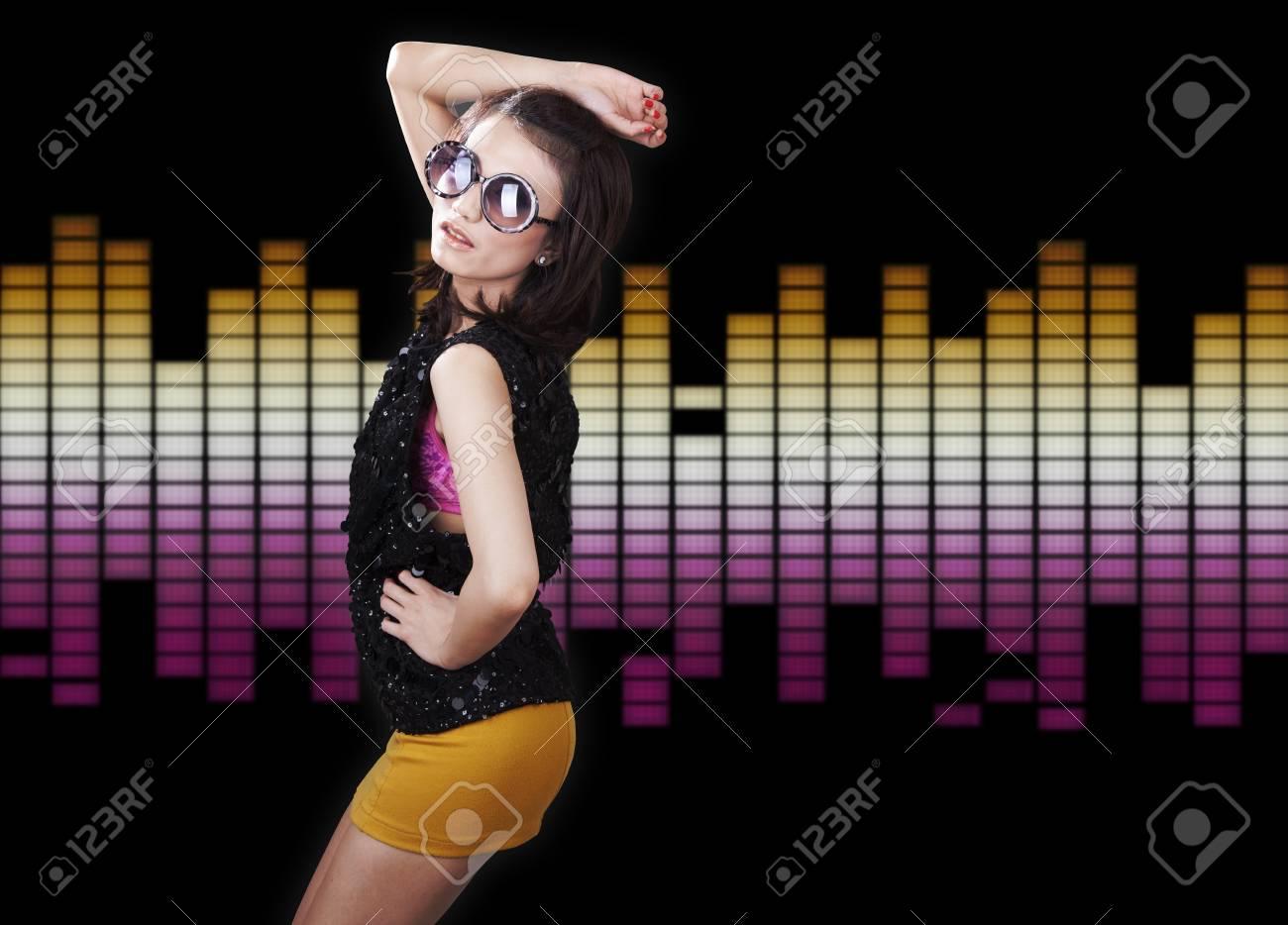Pretty Mixed caucasian-asian woman dancing with sunglasses Stock Photo - 11252385