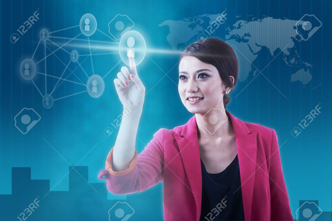 Businesswoman pressing social network icon over futuristic background Stock Photo - 11533376