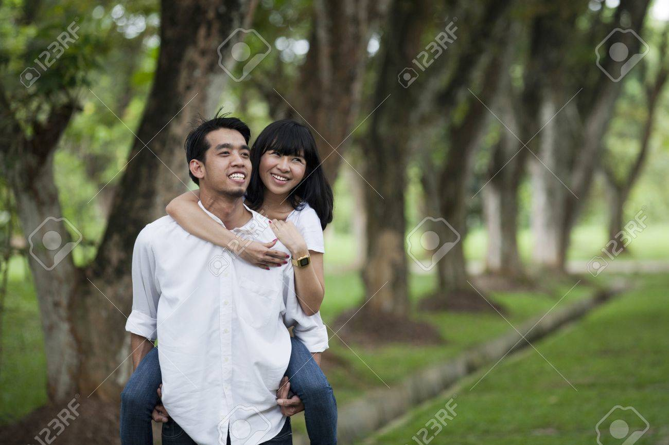 Happy young couple playing around in the nature Stock Photo - 12150225