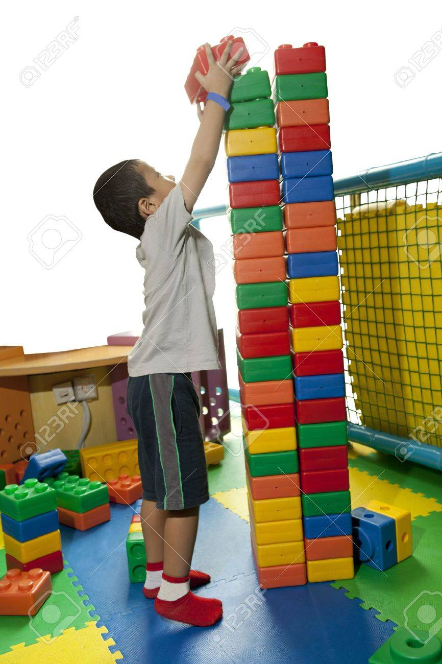A little boy seriously build tower block Stock Photo - 12150232