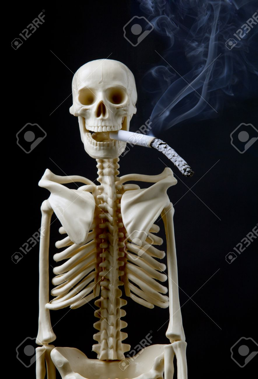 Quit Smoking Concept A Human Skeleton With Cigarette On Black