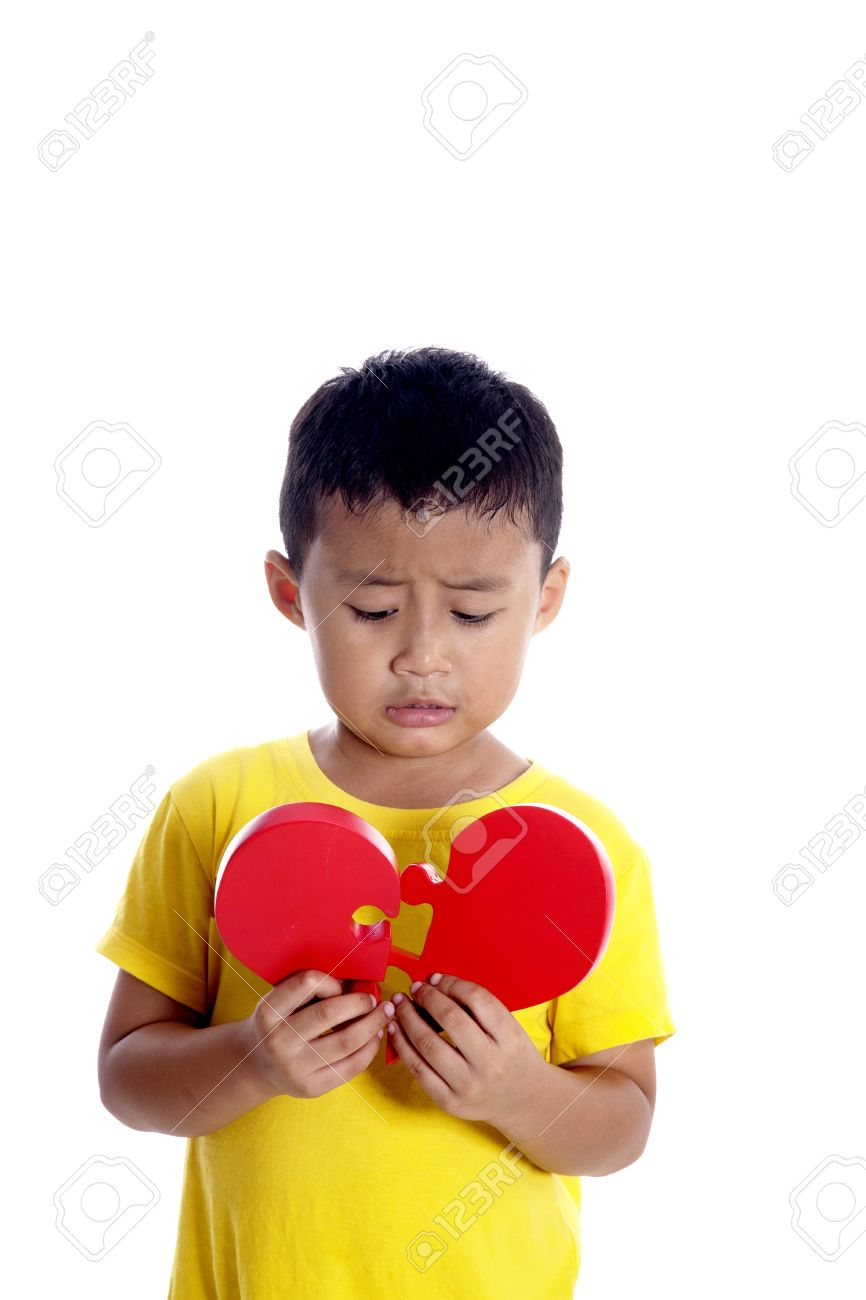 Sad Boy Holding Red Puzzle Of Broken Heart Stock Photo Picture And