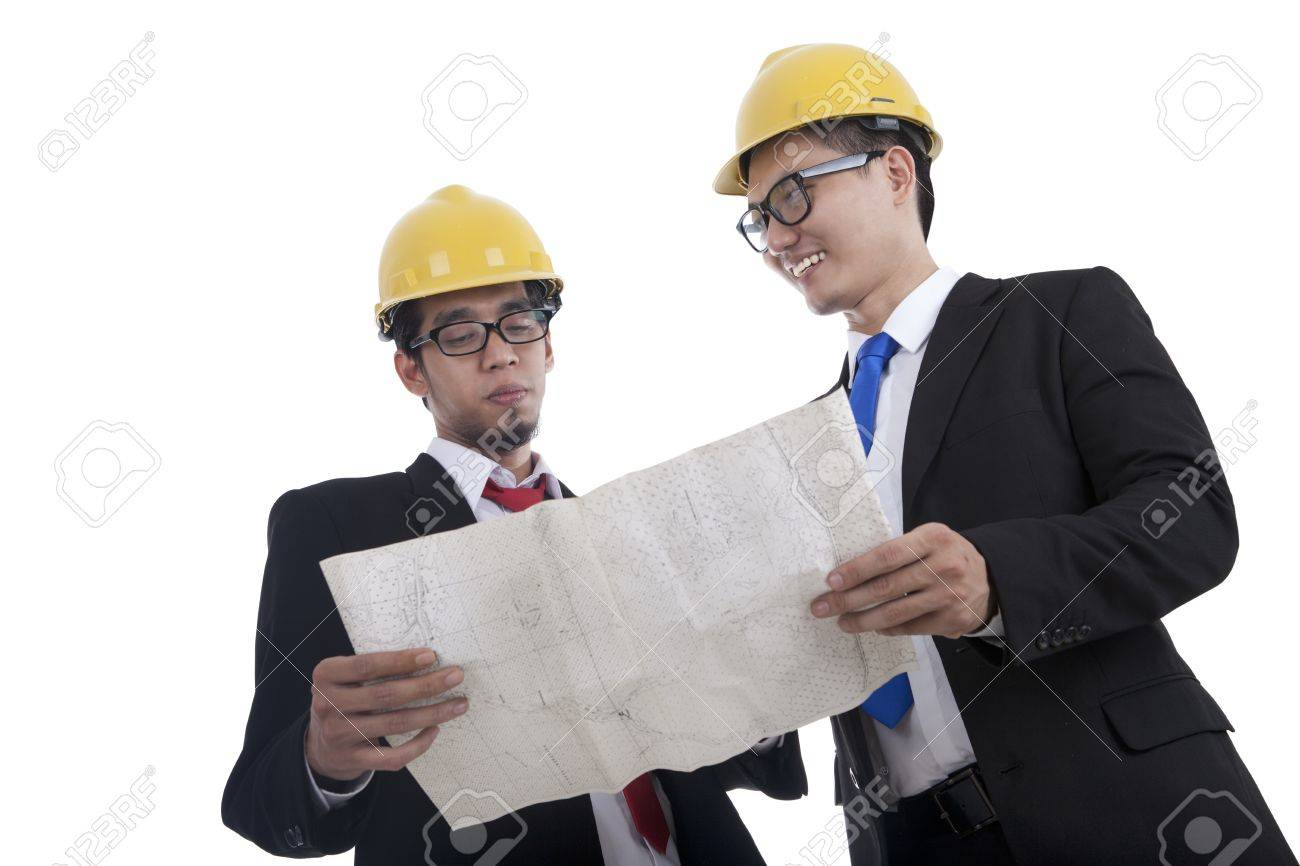 architect and construction engineer or surveyor discussion plans