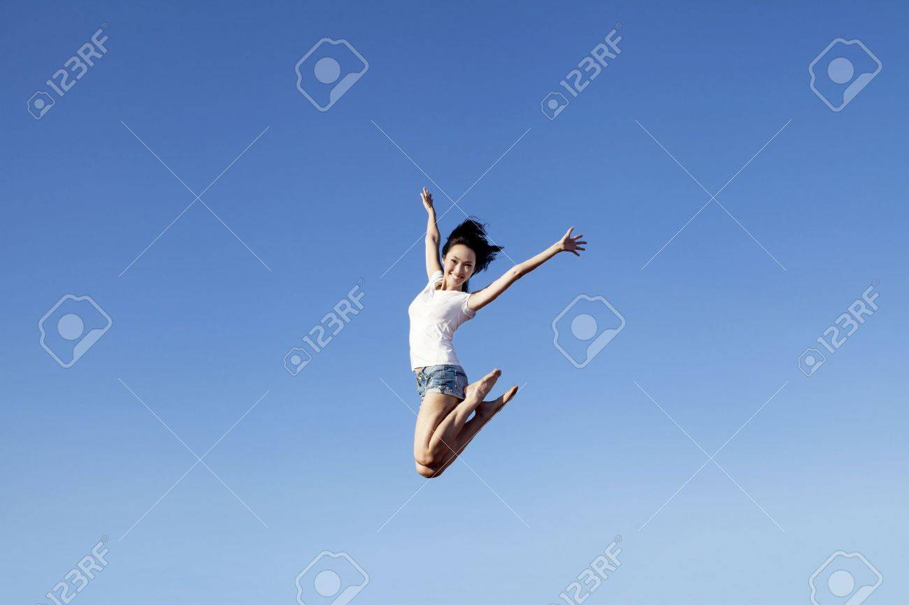Slim asian woman jumping expressing her happiness Stock Photo - 14683504