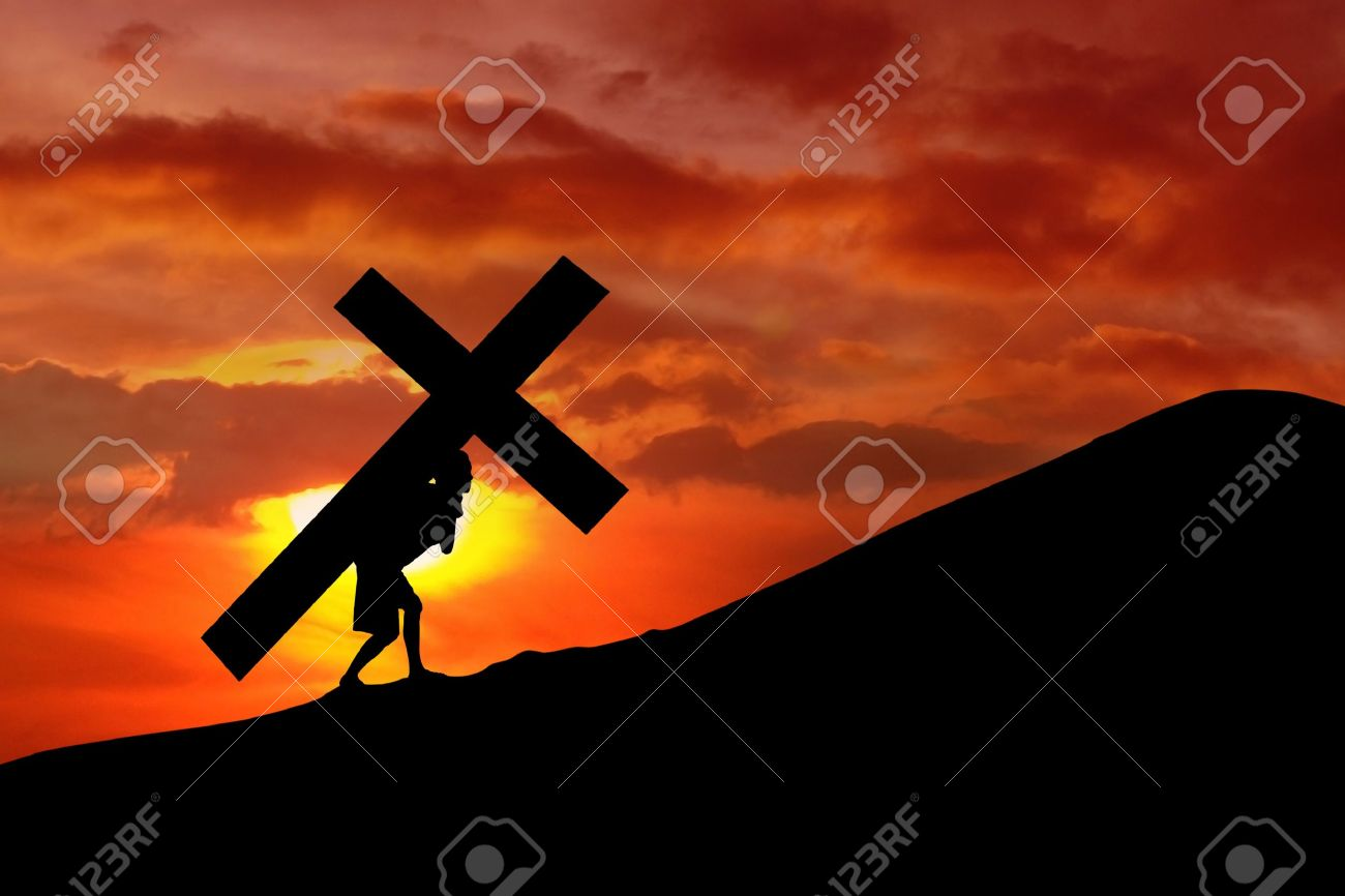 the figure of jesus christ carrying the cross up calvary on good